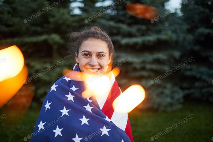Happy patriotic American girl in forest