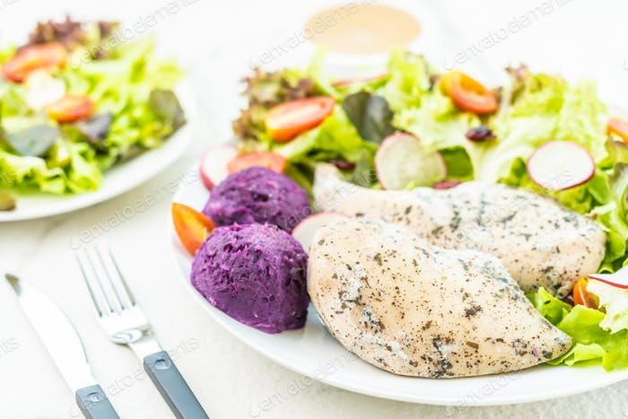 Grilled chicken breast meat steak with fresh vegetable
