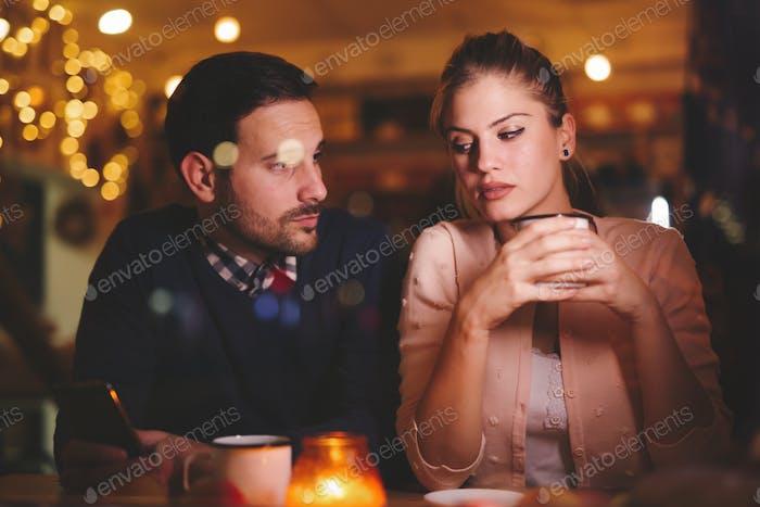 Sad couple having a conflict