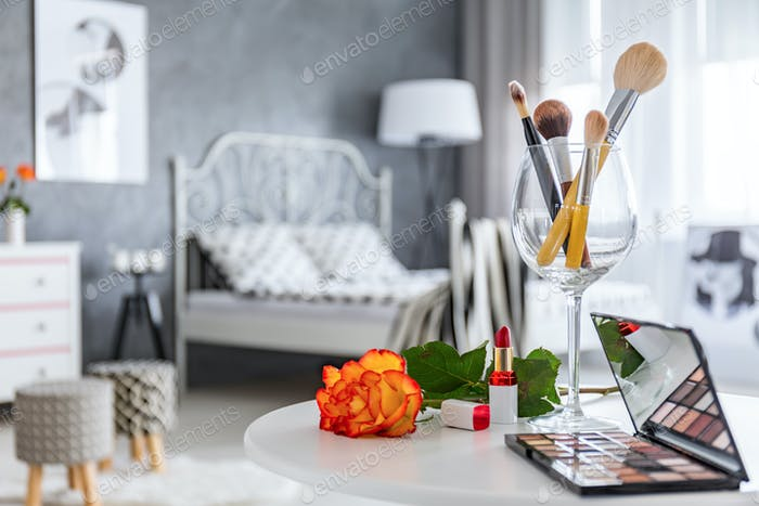 Makeup accessories lying on table