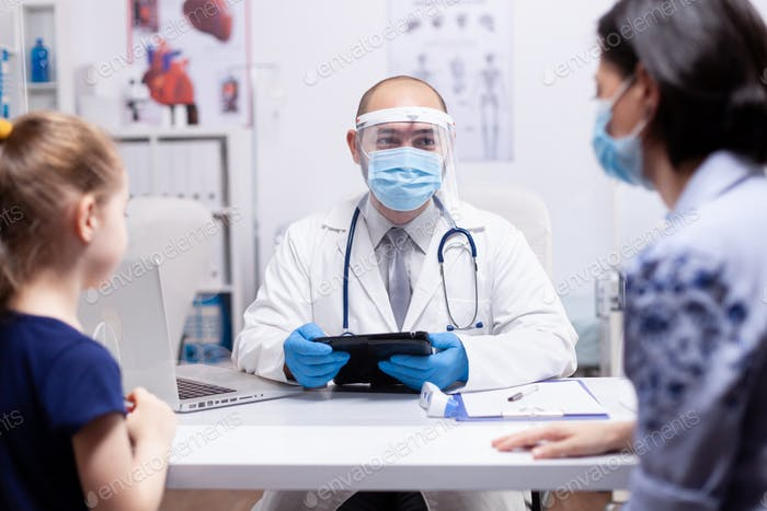 Doctor with face mask and visor