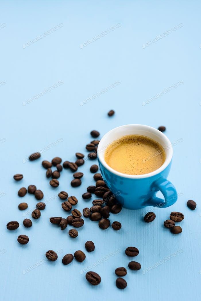 Blue espresso cup on blue