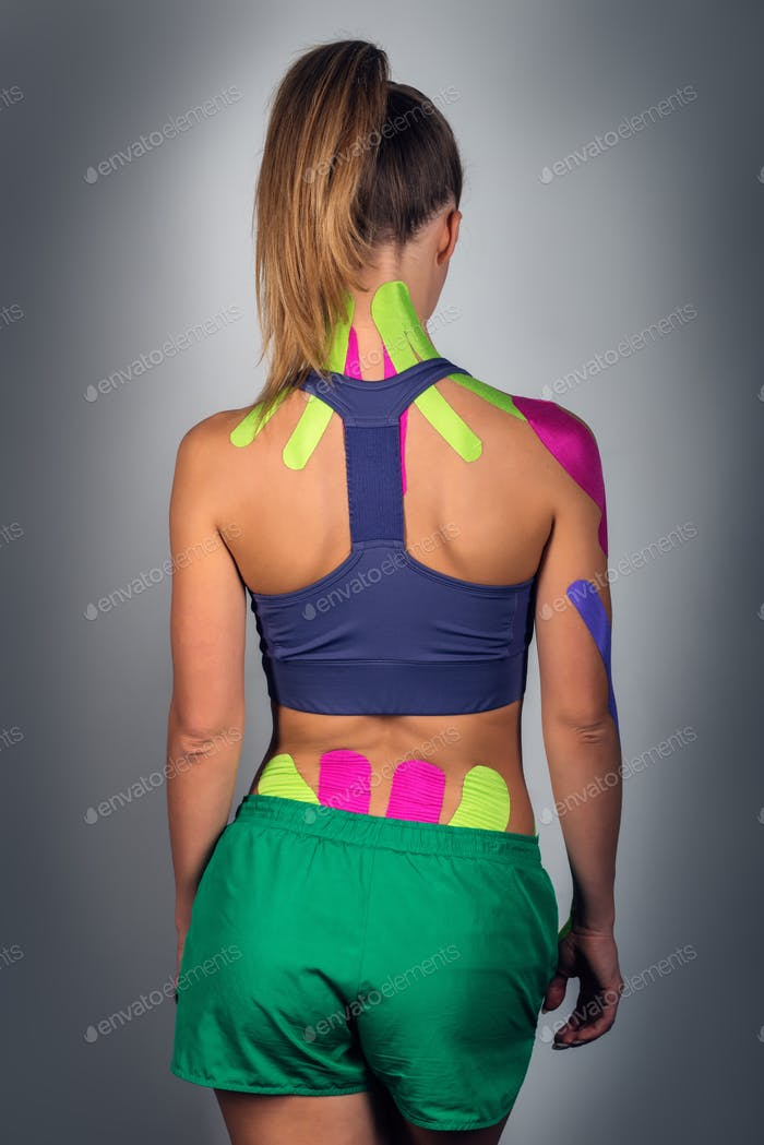 Back of a young athletic girl, alternative kinesitherapy