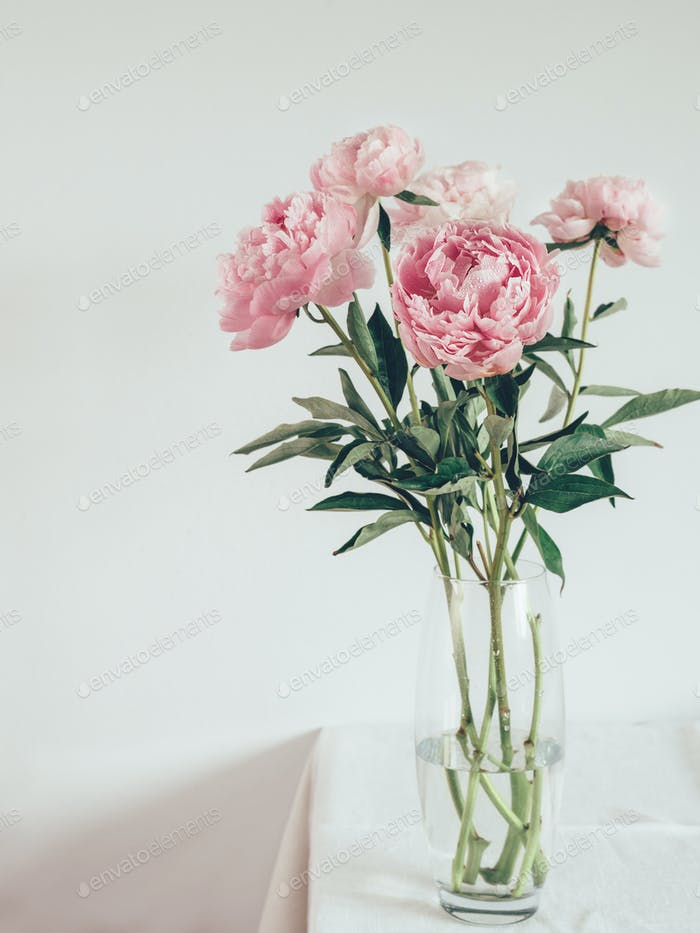 peony bouquet in vase on white table