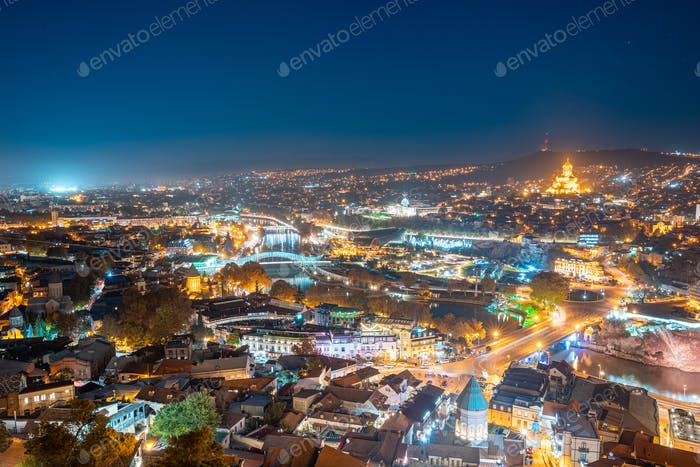 Tbilisi, Georgia. Elevated Rooftop View Of Famous Landmarks In Night Illuminations. Georgian Capital