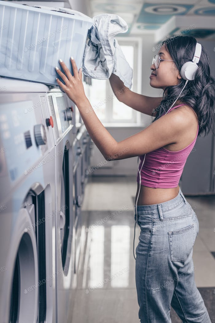 Smiling girl in laundry