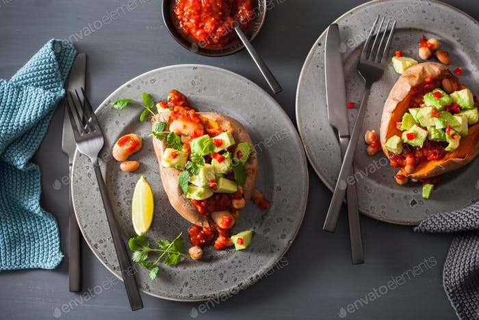 baked sweet potatoes with avocado chili salsa and beans