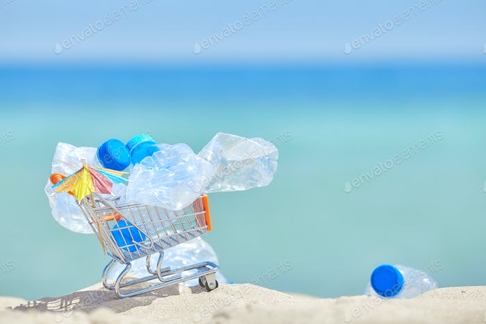 Miniature shopping cart with empty plastic bottles.