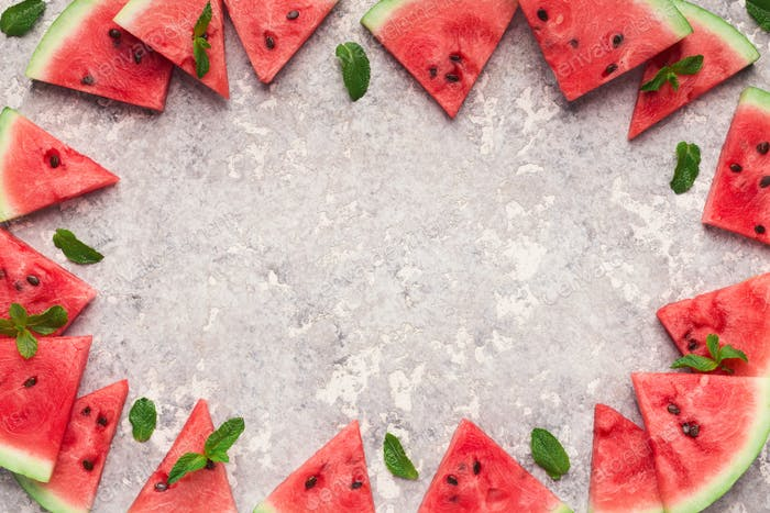 Sliced watermelon border on grey background, top view