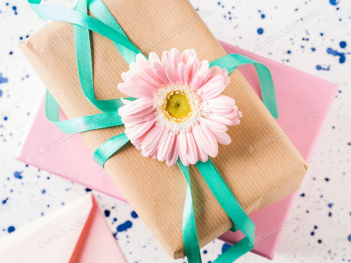 Stacked gift boxes with flowers. Pastel colors