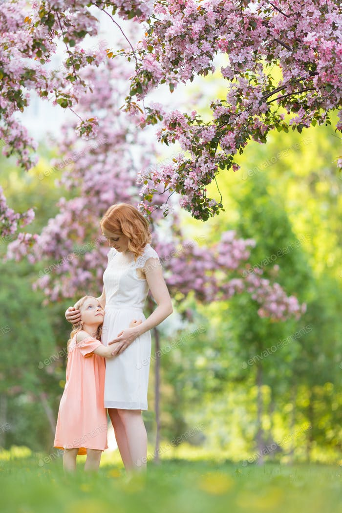 Mother and daughter in a garden