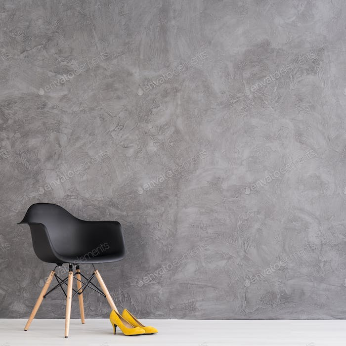 Modern chair and yellow high heels