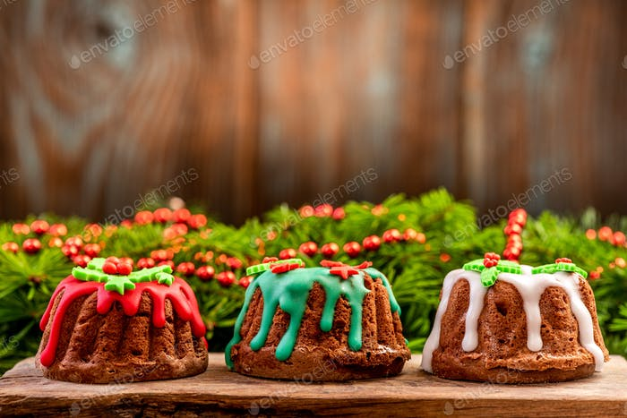 Festive Christmas Cakes , Wooden Background Copyspace