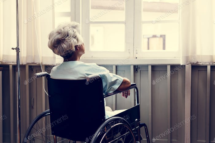 Old woman on a wheel chair