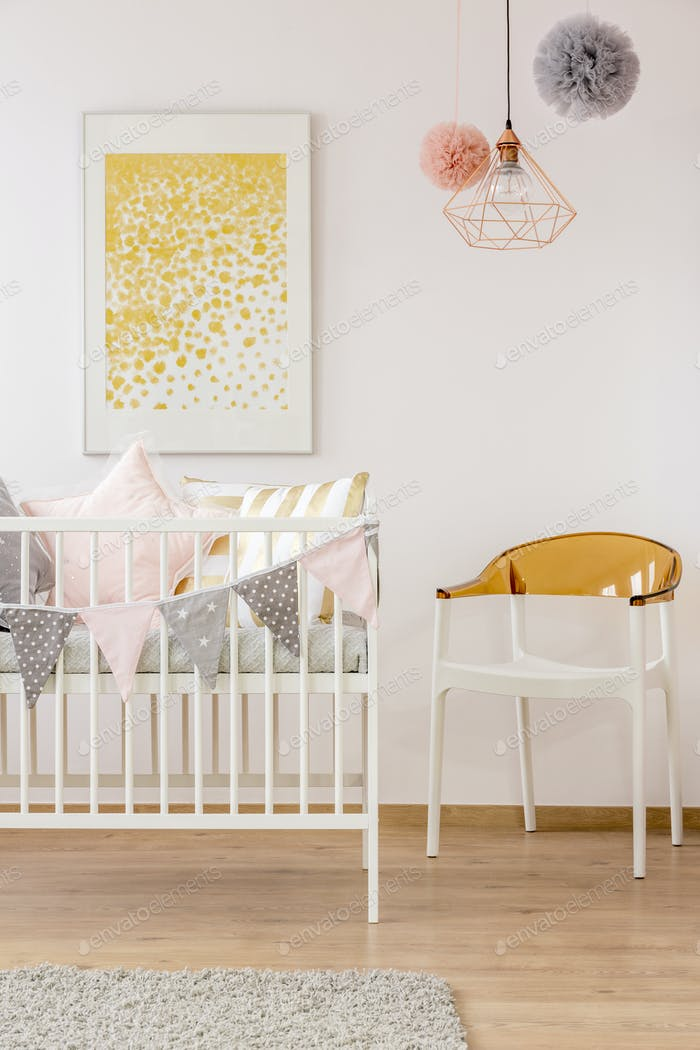 Poster over cozy nursery crib