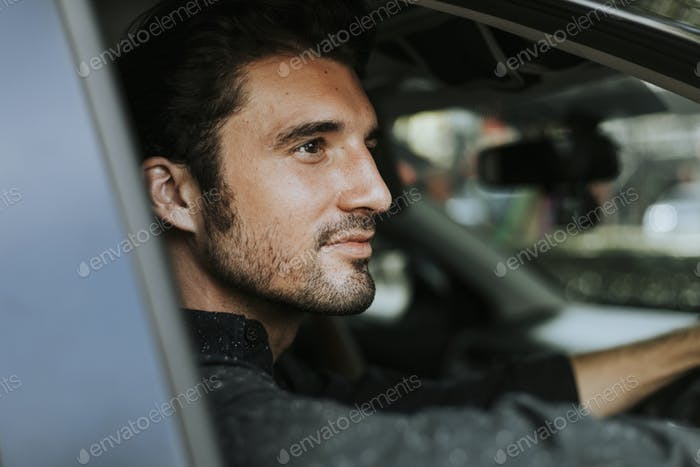 Handsome man in a car