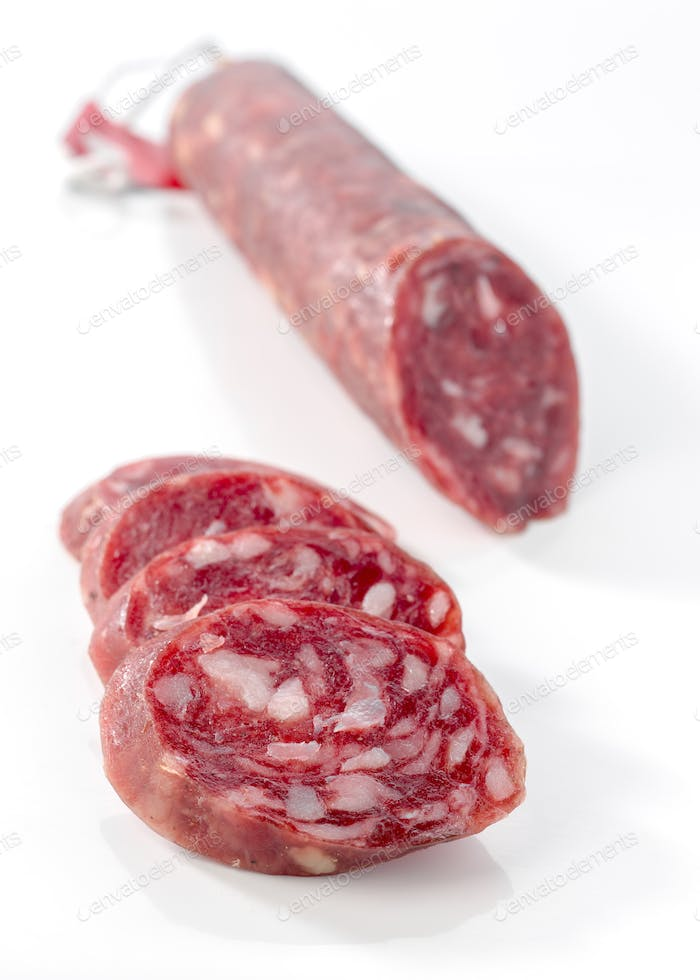 Iberian pepperoni isolated on white