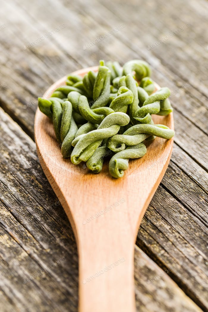 Uncooked spinach gemelli pasta.