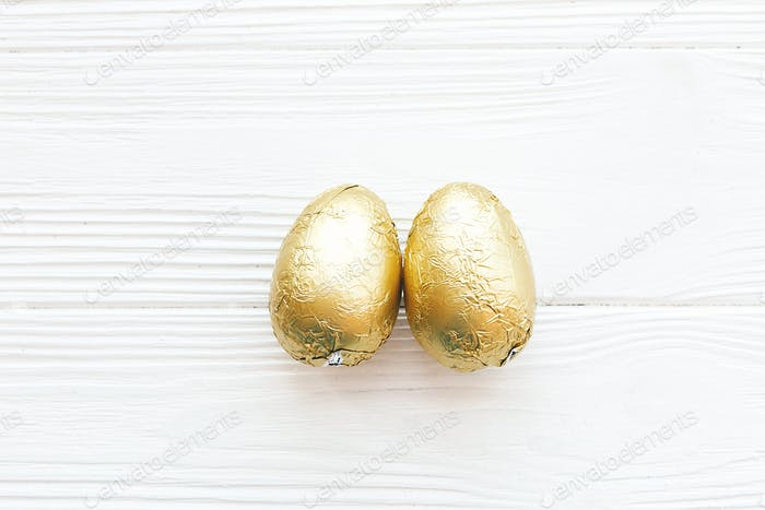 Stylish Easter eggs in golden foil