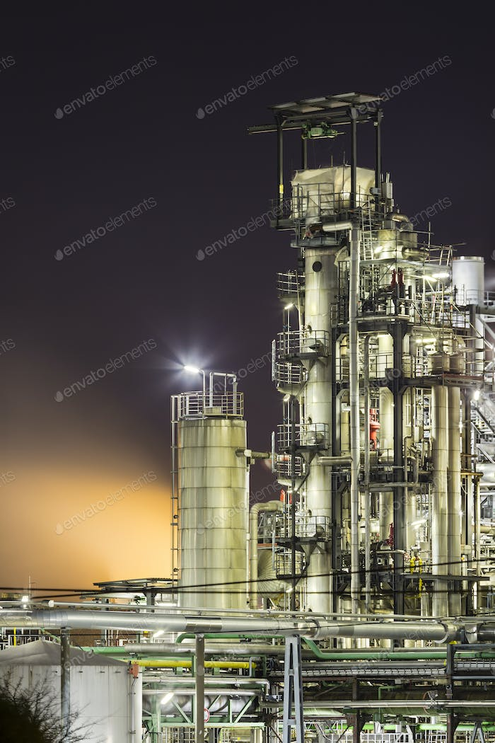 Refinery Towers And Steam At Night