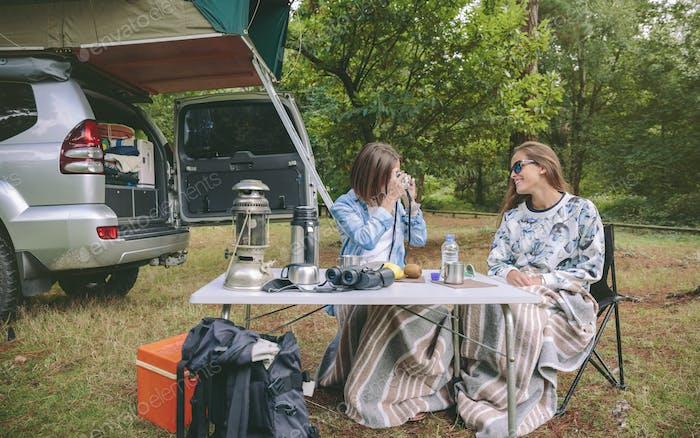 Woman taking photo to friend in breakfast
