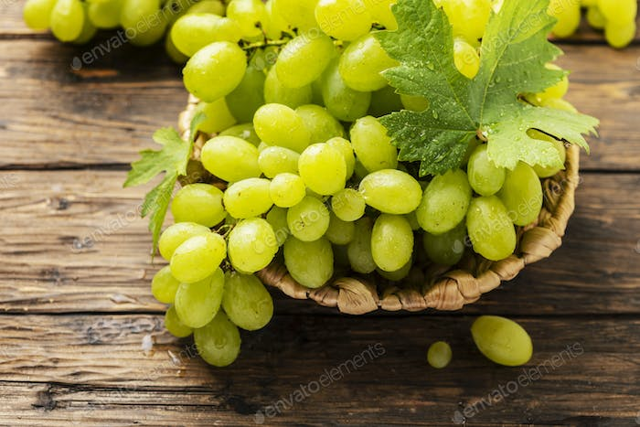 Sweet yellow grape with leaves