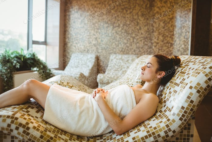 Woman relaxing while lying down at the spa
