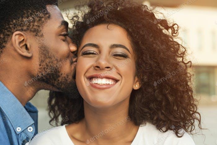 Couple in love. Boyfriend kissing his girl
