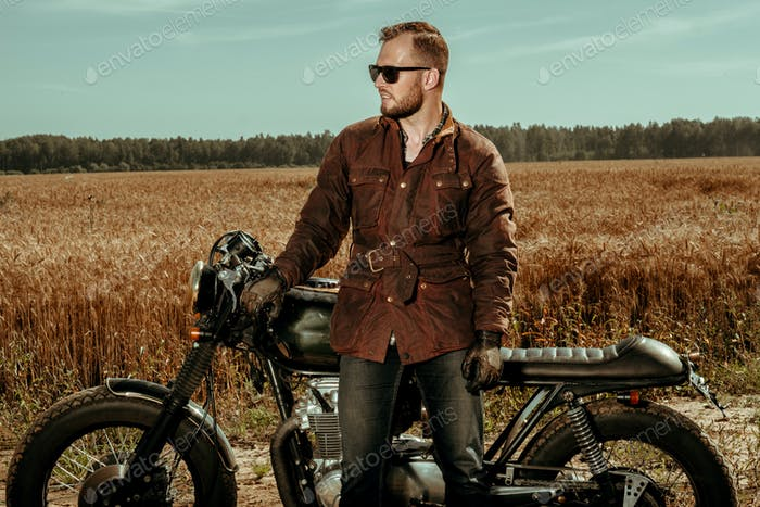 Rider with his vintage custom made cafe racer
