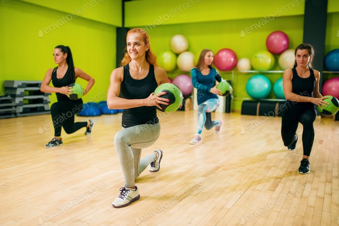 Women group with balls in motion, fitness workout