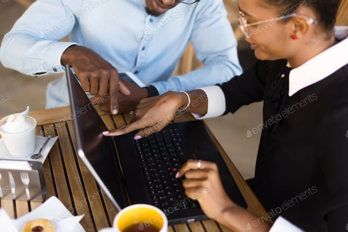 Black  African American coworkers doing digital teamwork arround