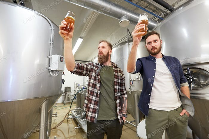 men testing non-alcoholic craft beer at brewery