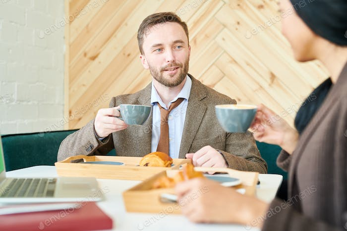 Handsome Businessman with Cup of Coffee in Cafe
