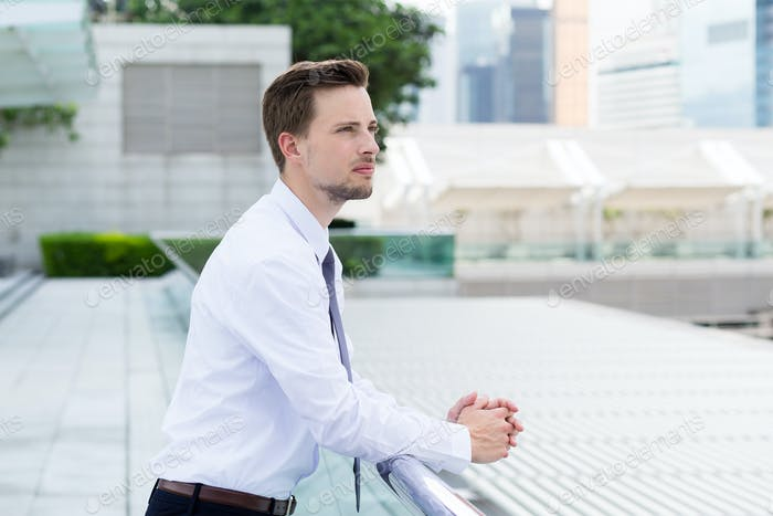 Businessman think of something at outdoor