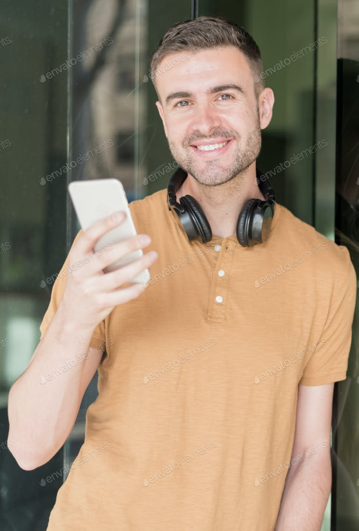 man with mobile phone and headphones