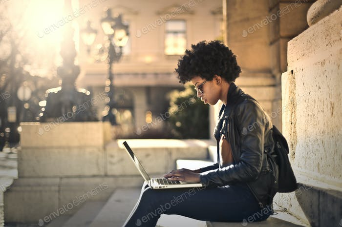 Girl with a laptop outdoor