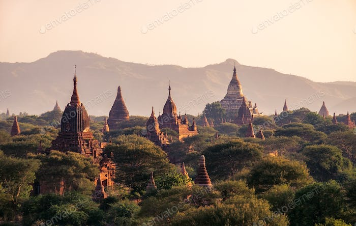 Landscape view of ancient temples at colorful golden sunset, Bagan, Myanmar
