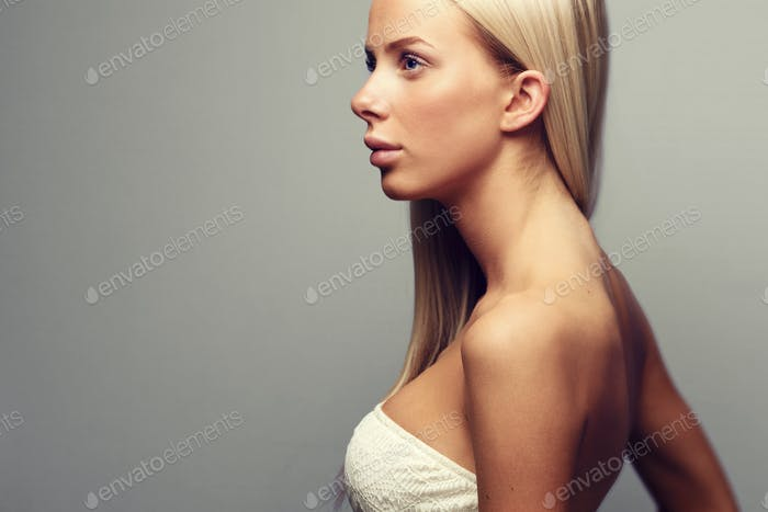 Fashion portrait of a blonde woman in with attitude