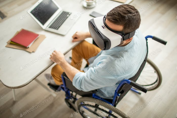 Handicapped man with vr goggle
