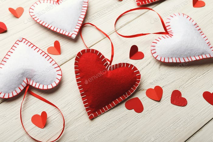 Valentine day background, handmade pillow hearts on wood, copy space