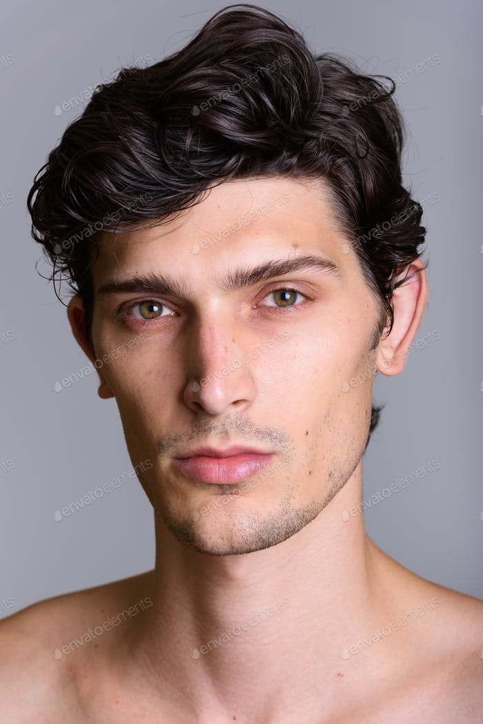 Face of young handsome Brazilian man shirtless