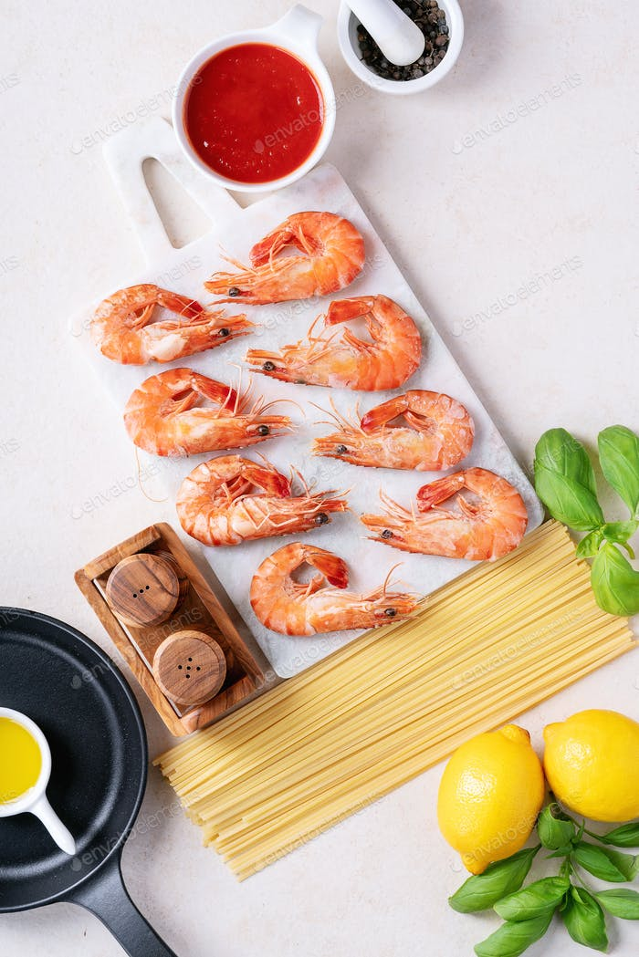 Raw ingredients for cooking: Shrimp prawns Italian spaghetti