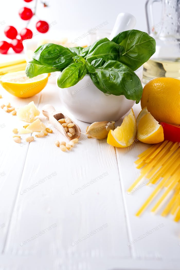 Food ingredients for italian pasta, spaghetti on white wooden background. Copy space of your text.