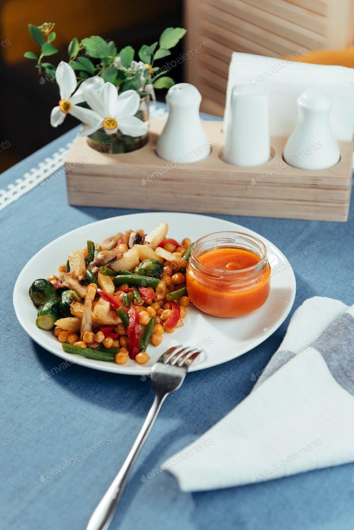 steamed vegetables a mushrooms and sauce. Advertising shooting menu.