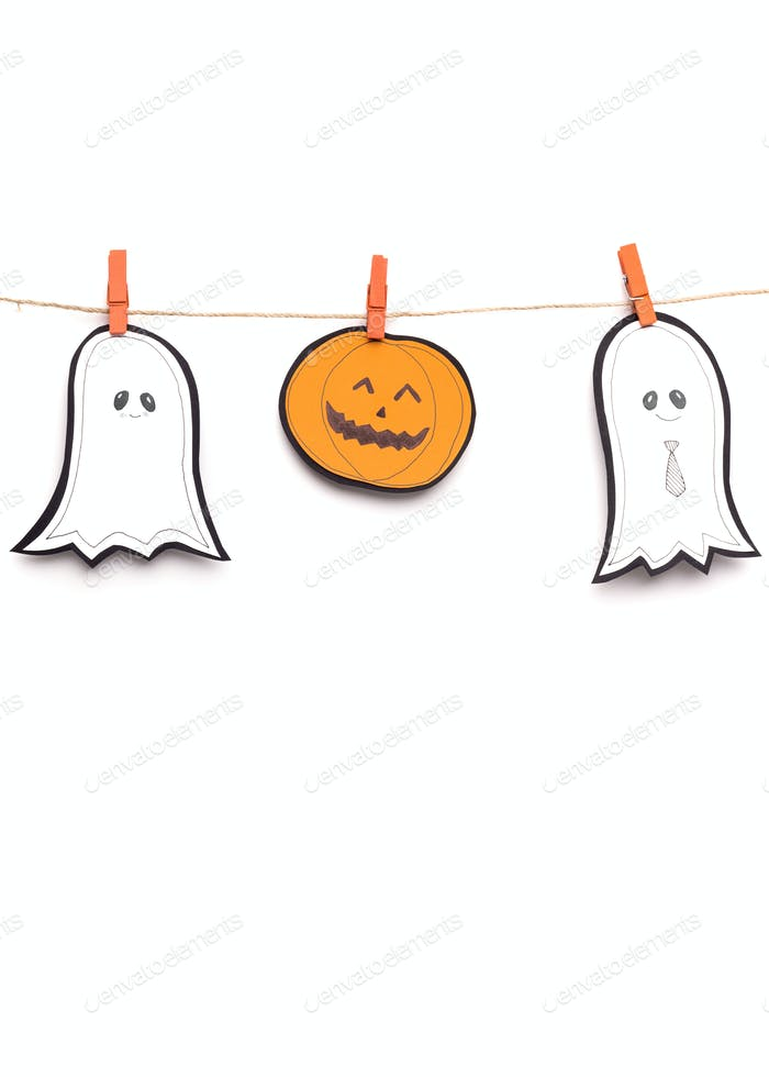 Close up of paper Halloween figures hanging out on rope