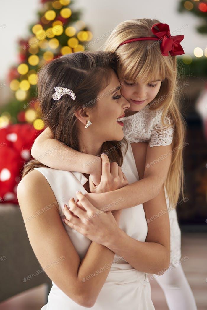 Daughter hugging mummy so tight