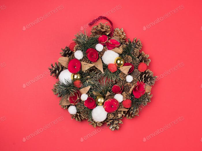Beautiful Christmas wreath decoration on red background