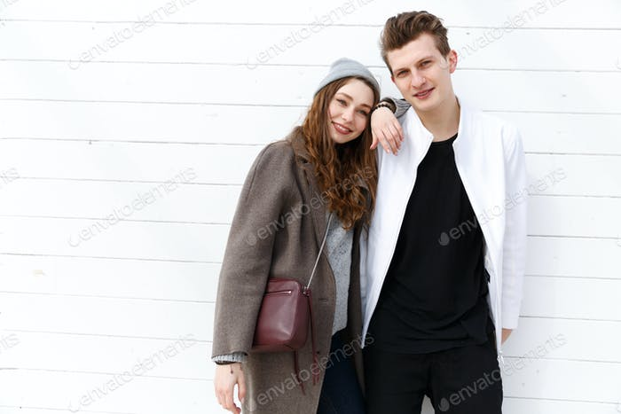 Beautiful young couple standing together