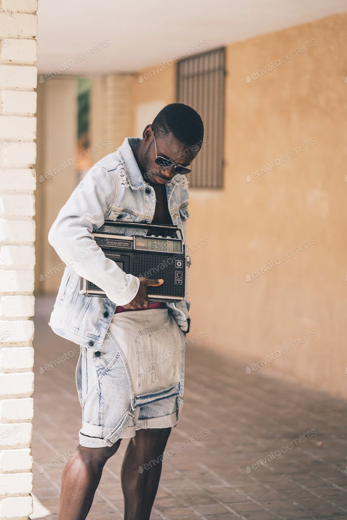 African man with vintage radio device.