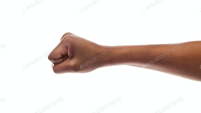 Black female hand showing clenched fist on white background